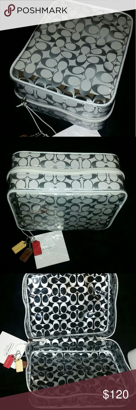 NWT! COACH Clear Cosmetic/Toiletry Travel Case New with tags! Beautiful Coach large cosmetic and toiletry case. Signature logo and comes with three hangtags that can be used as keychain tags. Easy to wipe clean since it is resistant to water! Perfect gift or personal use! Thanks for shopping!  ❌❌ NO TRADES. Thanks. ❌❌  👍👌Serious buyers feel free to submit an offer!💖  Check out my other items! Coach Bags Cosmetic Bags & Cases