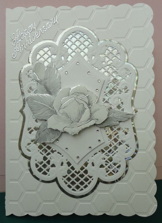 Wedding anniversary card. The art work in the centre is from a sheet of silver and white die cuts.