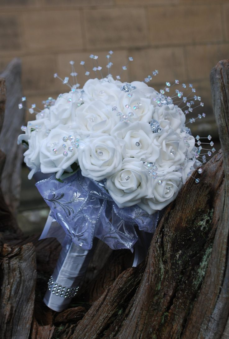 Shimmering brides bouquet of white rose with silver ribbon rose and crystal stems