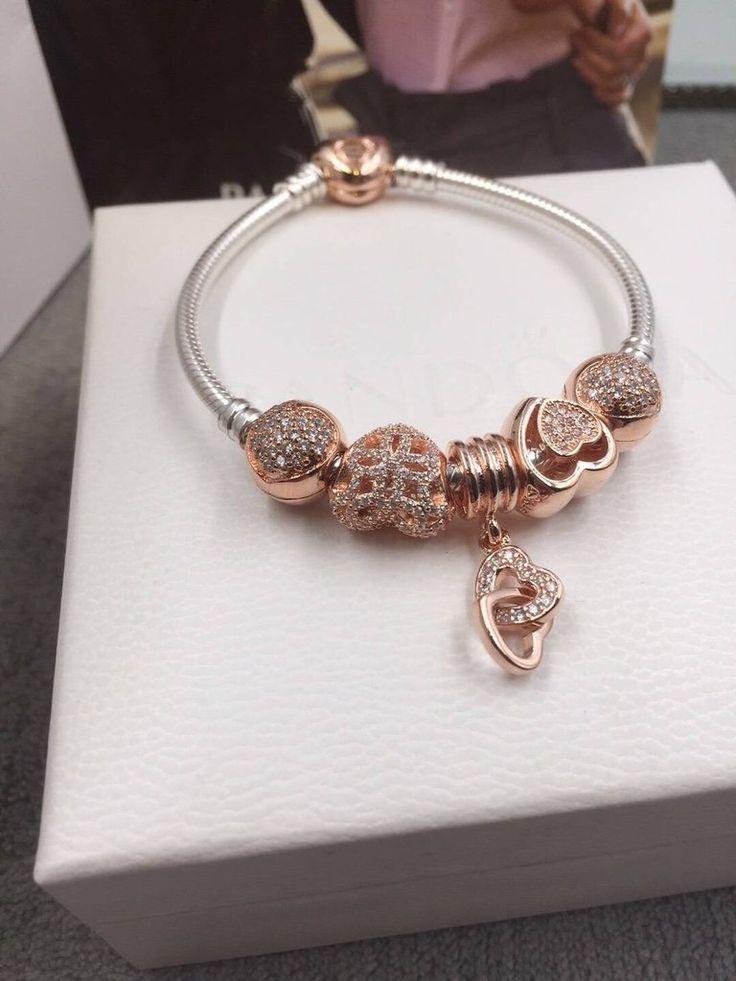 $143 Pandora gold charm bracelet
