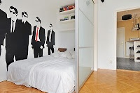 I love the bedroom created in this space, as well as the wall graphic.