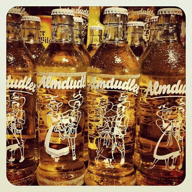 """Almdudler drink - is the brand name of a popular carbonated soft drink from Austri. The original Almdudler is a sweetened carbonated beverage made of herbal extracts. Almdudler has been called the """"national drink of Austria"""". Its popularity in Austria is second only to Coca-Cola. About 80 million litres of the beverage are produced per year."""