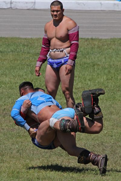 wild wrestling outfits in Mongolia...haha i think ammerz found our boys @Bree Tichy Masters