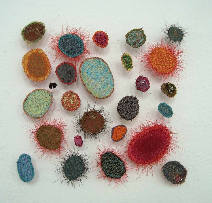 """MARIAN BIJLENGA-NL """"In every work by Dutch fiber artist Marian Bijlenga, many small and similar--but never identical--elements are stitched into a web of invisible nylon thread to create a harmonious whole. Whether a thousand small dots radiating out from a corner point or two hundred curved lines suggesting watery swirls, her work is characterized by repetitive, lacelike elements that float, touching neither each other nor the wall from which they are suspended"""""""