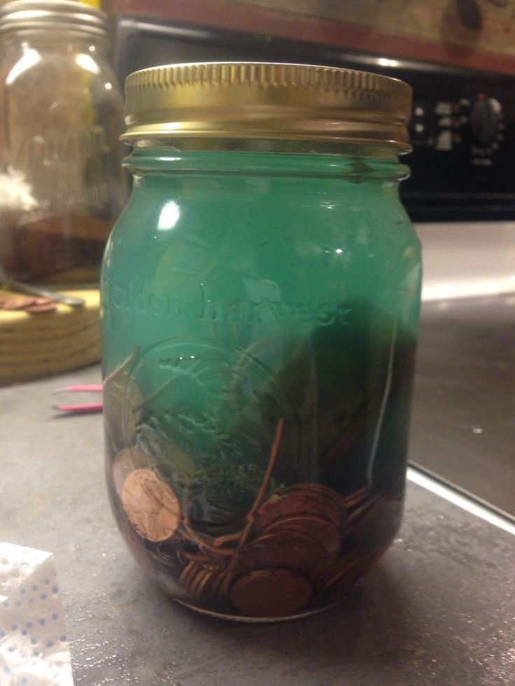 Jar of pennies+vinegar+some peroxide... Green wood stain