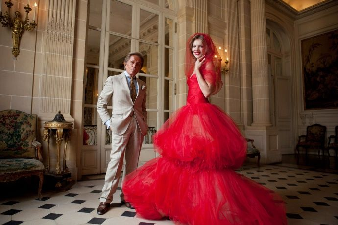 Mr. Valentino Puts the Finishing Touches on Natalia Vodianova's Love Ball Dress for of her Russian playgrounds-for-children project, The Naked Heart Foundation.