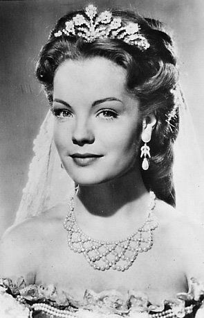 Romy Schneider as Sissi, die junge Kaiserin (2, 1956) dressed as the Queen of Hungary.