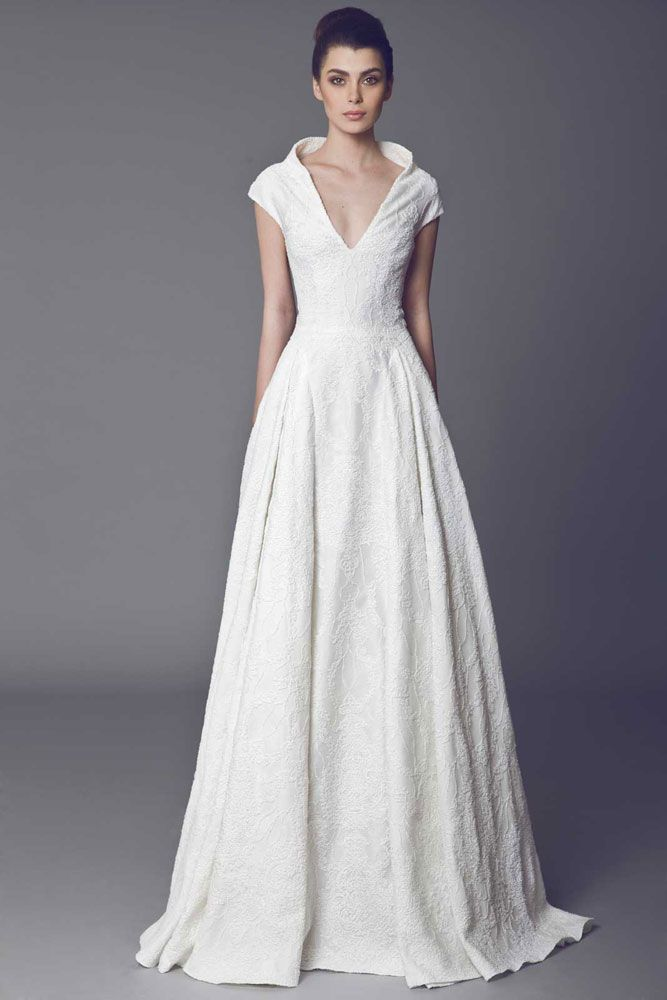 Off White Silk Zibeline gown covered with Lace, with high collar.  More info at: http://www.efr7.com/shop/the-bride/arome/#sthash.bxdFS15y.dpuf