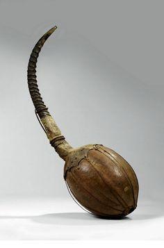 Africa | Transverse flute from the Shilluk or Bari people of Sudan | Gourd, antelope horn, animal hide and natural fiber
