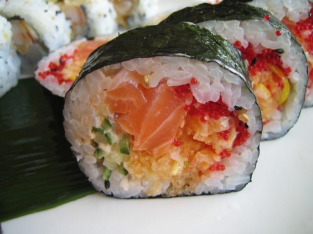 the Kamikaze 2 (salmon, tempura flakes, cucumber, fish egg, and small slices of lemon) rol