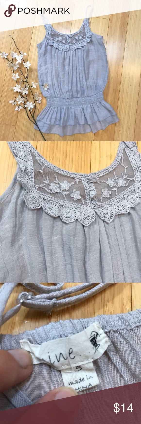 MINE gray tank top, S. Lightweight silver gray tank top by Mine, size small. Washer dryer safe, material is a combination of cotton and rayon. Cute embellishment, smocked waist, adjustable straps. Bust measures 20 inches across, length is 25 inches. Good condition. Mine Tops Tank Tops