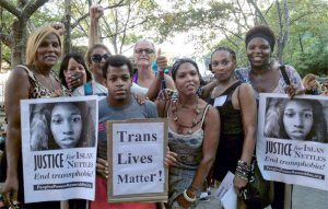 At a vigil for Islan Nettles, a 21 year old transgender woman murdered in Harlem. -- ZILLAH (middle women with necklace)