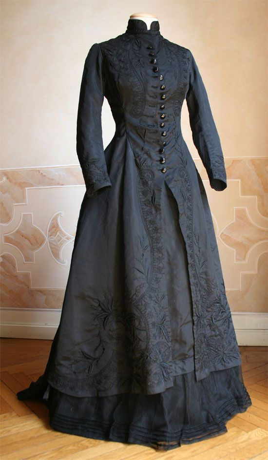 Mourning dress in two pieces, black silk faille embroidered in black with decorative lacing  c. 1877