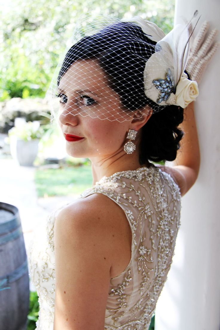 Back of my wedding dress, Blakely by Maggie Sottero. Fascinator by Embellish. Photo by www.questphotography.ca