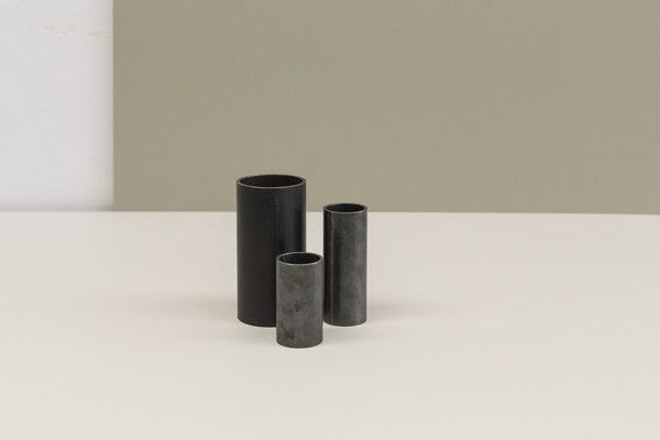 Our Black Steel Cylinder Vases are created to stand as a beautifully simple utilitarian cylinder vessel for any number of dry uses or are perfect with our Marka