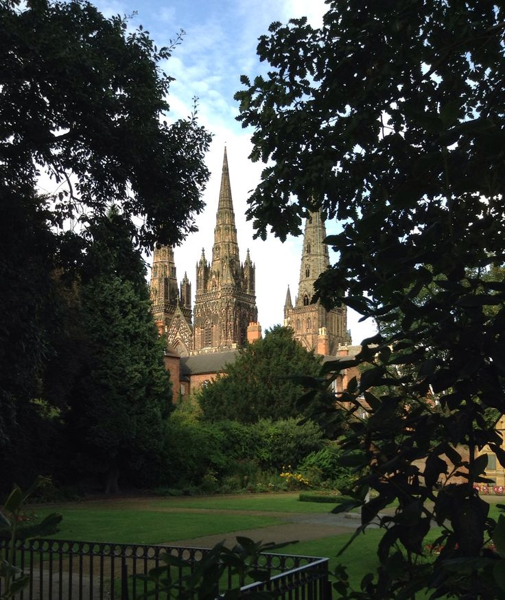 The spires of Lichfield Cathedral through the trees