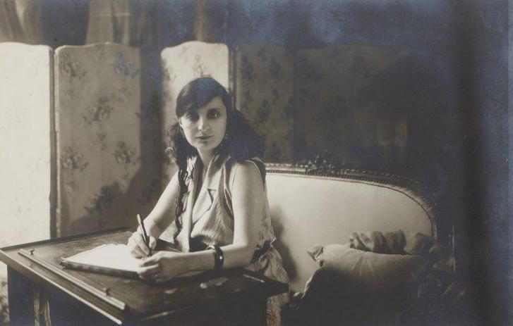 Portrait of la comtesse Anna de Noailles (1876-1933) french writer, poet At home, sitting at her writing table Photography: Otto (1849-1924) Paris, 1914