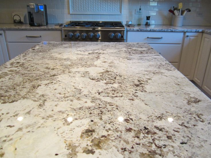 White Alaska Granite - this may be my new favorite countertop material.  Just the right mix of grays, beiges, and white.  So versatile.