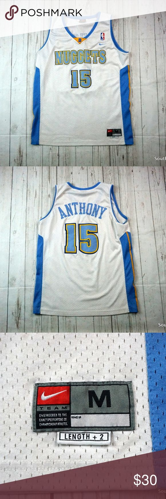 "Nike Denver Nuggets #15 Carmelo Anthony Jersey M Men's Nike Denver Nuggets #15 Carmelo Anthony White NBA Swingman Jersey Sz M  Jersey is in good condition overall has no rips stains or tears. Minor fading on the letters and numbers due to age  Brand: Nike Size: Men's Medium Material: Polyester  Detailed Measurements: (Front Side of Garment has been measured laying flat on a table)  Chest:                     22"" inches Length:              28"" inches  Ships in 1 business day or less from a…"