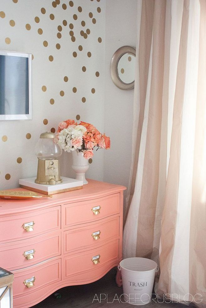 Love this coral color dresser and the gold spots !