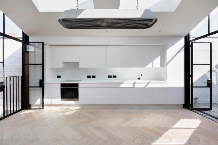 From single-storey storage garage to a beautiful two bedroom house that has skylights positioned above each family space - CAANdesign | Architecture and home design blog