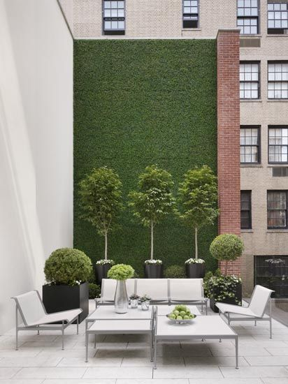 """Sleek, """"city"""" outdoor living room, with a tiled patio deck. These walls would be creeping fig in the South, but you'd have to water the sam hill out of this Greenery Wall to keep it alive in Downtown Atlanta!  Great pic from cococozy"""