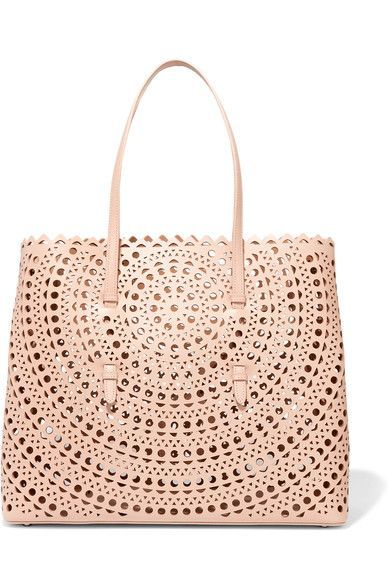 Alaïa's coveted 'Vienne' tote is crafted from smooth blush leather and signature laser-cut perforations. This convenient open-top style has hand-painted edges - an example of the house's careful attention to detail. It comes with a zipped pouch to keep smaller items and valuables secure.