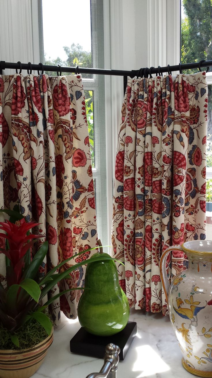 custom pleated cafe curtains in a floral design.