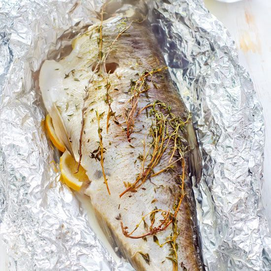 Baking Fish In Foil with a medley of aromatic ingredients creates a truly flavorful dish, and is a breeze to clean up.data-pin-do=
