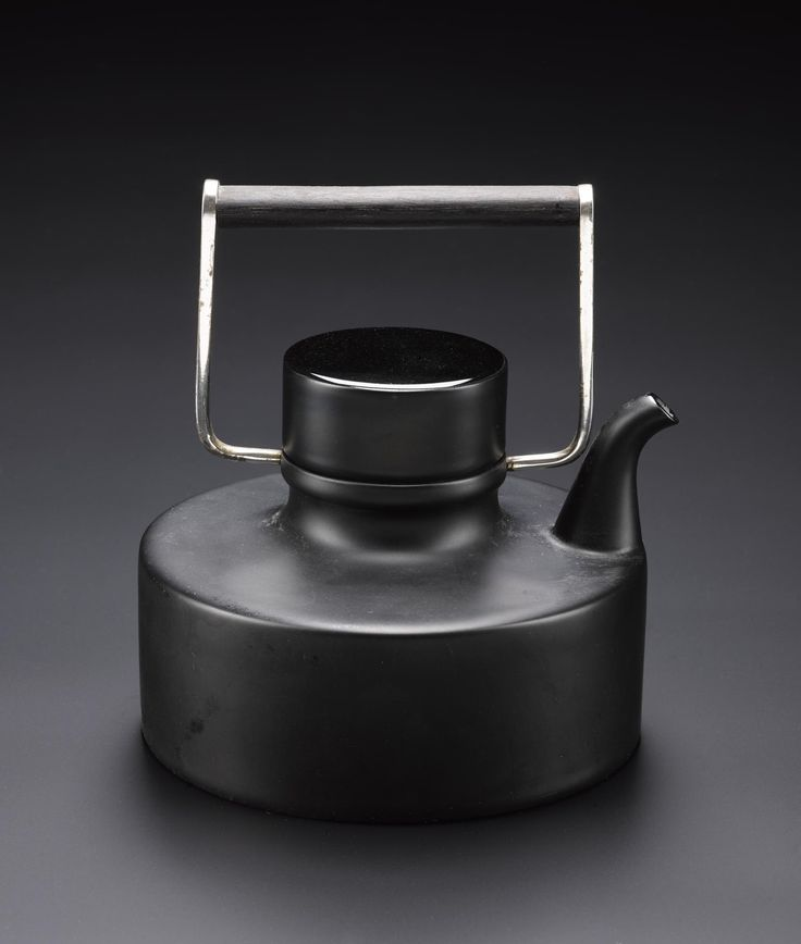 Teapot and lid, of black matt ceramic, with metal handle, called 'Tea for Two', designed by Tapio Wirkkala for Rosenthal, Germany