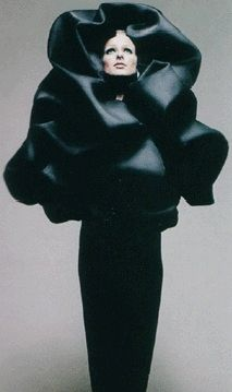 A Balenciaga evening cape that is art/function that rocked fashion in the 60's. Photo by Hiro, 1967.