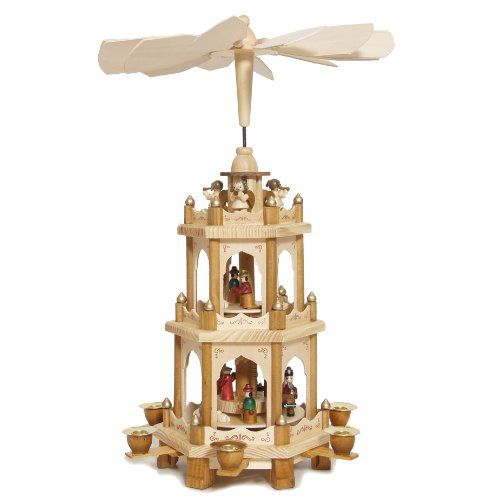Christmas Pyramid 18 Inches Nativity Play - 3 Tier Carousel with 6 Candle Holders - Brubaker Design From Germany. Including 6 candle holders.please use candles 5/8'' Diameter 4''H - not included. The natural material wood is enchanting. Handpainted 3 Level Christmas Nativity Pyramid with 2 moving levels, plus the third level with the stationary angels on top. The ideas to these pyramids are deeply rooted in the german handcraft traditions. 18 inches = 45 cm high. Handpainted figures.