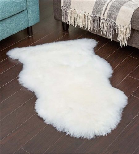 Ivory Sheepskin Throws - Made from natural shearling pelts of New Zealand. Thick merino wool sheepskin hides at the lowest price in Canada. Shop Today!