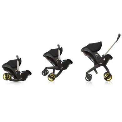 DOONA Babyschale Doona Plus schwarz(night) mit voll integriertem Fahrgestell, 2in 1