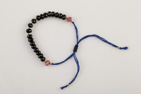 Handmade adjustable bracelets are made by quartz and special thread, to give a fine finish to your entire clothing. Coloured in Black Onyx with a deep blue tread, that has a solid presence.