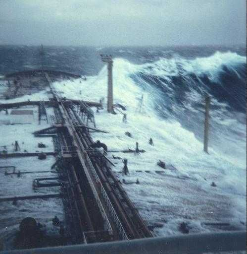 The picture below was taken on the oil freighter Esso Languedoc outside the coast of Durban (1980). The man who took it, Philippe Lijour, estimated the mean wave height when this occurred to be about 5-10 m. The mast on the starboard side is 25 m above the mean sea level. The wave approached from behind and broke over deck, but caused only minor damage.