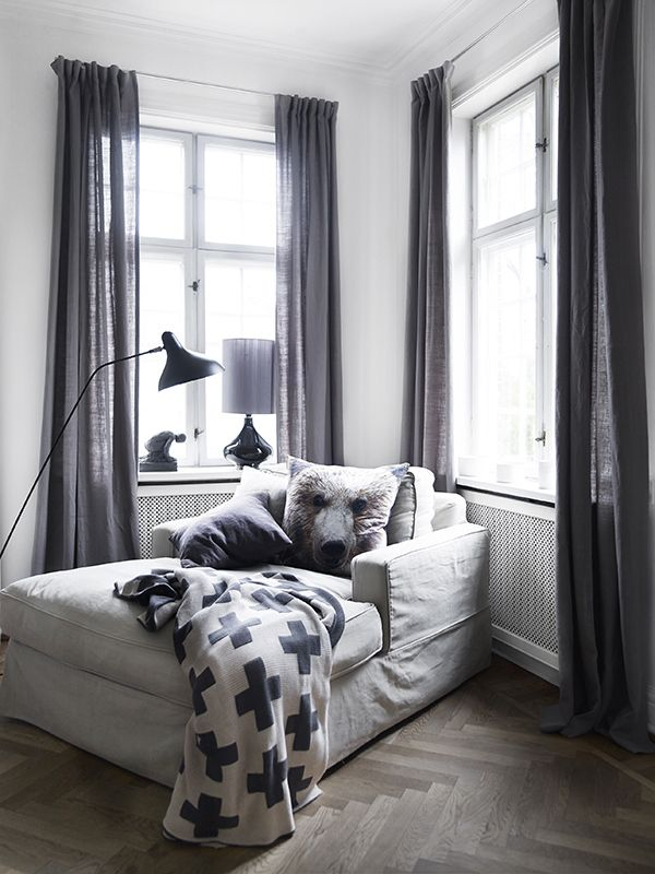 A neutral colored reading / lounging chair for the corner