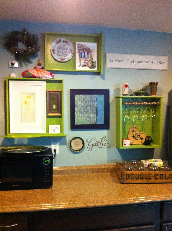 Old drawers found at the Habitat For Humanity Restore repurposed into a fun wall display complete with wine glass rack. This was fun to do!