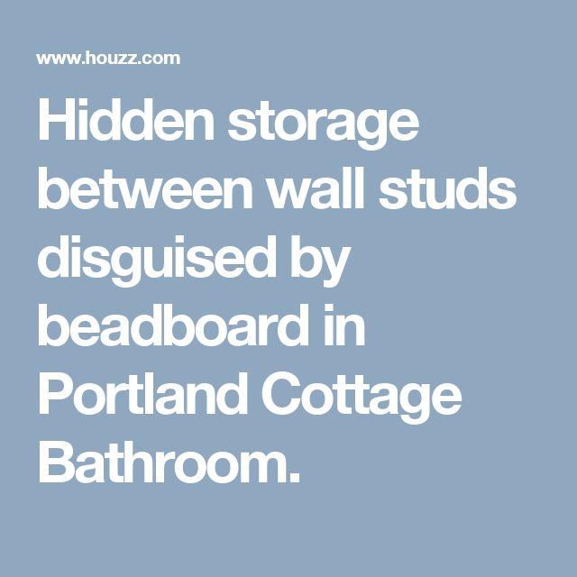 Hidden storage between wall studs disguised by beadboard in Portland Cottage Bathroom.