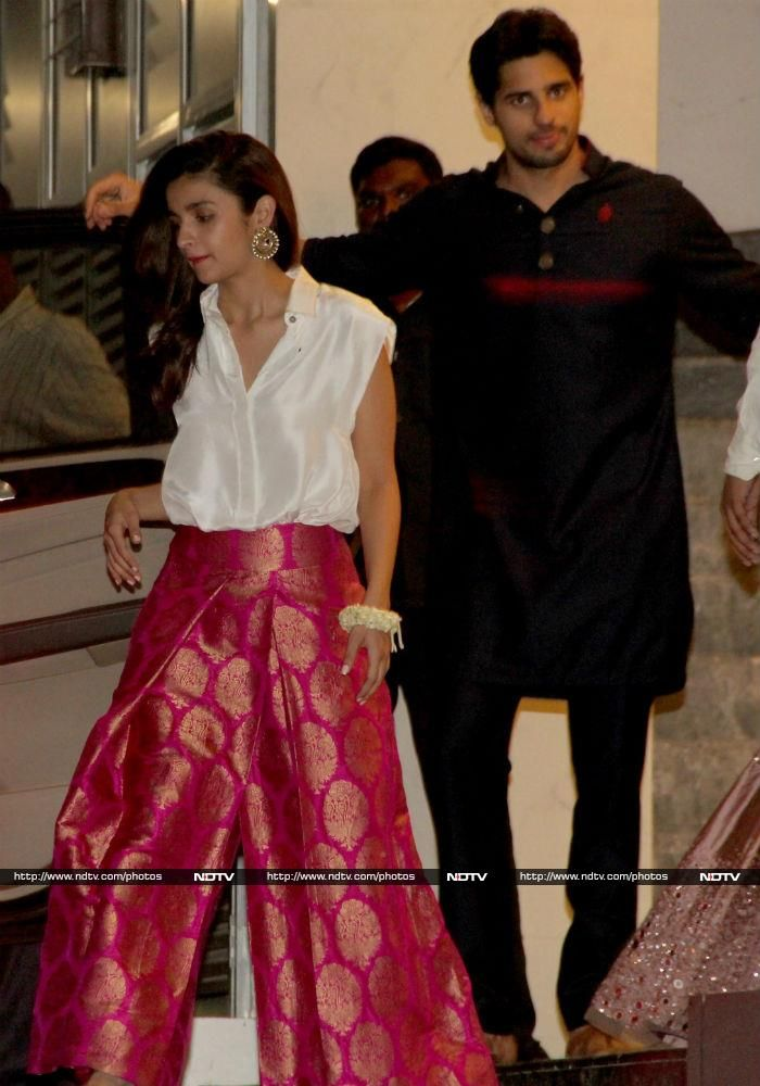 Bollywood's creme de la creme stepped out in their finest to attend a Diwali party hosted by Afasar Zaidi on November 6 in Mumbai. Student Of The Year co-stars Alia Bhatt and Sidharth Malhotra attended the party together. Alia wore a white shirt with pink brocade palazzos to great effect.