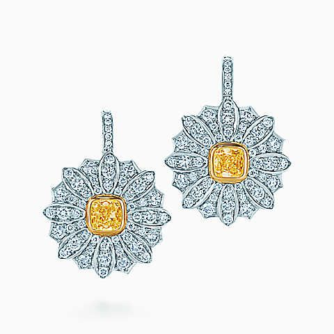 Daisy earrings in platinum and 18k gold with yellow and white diamonds.