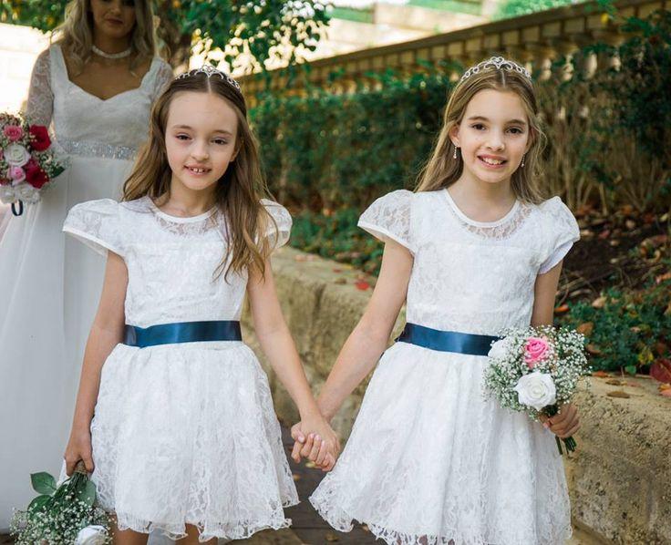 Flower girls walking down isle at Caversham House  Timika Prygoda Woodnote Photography