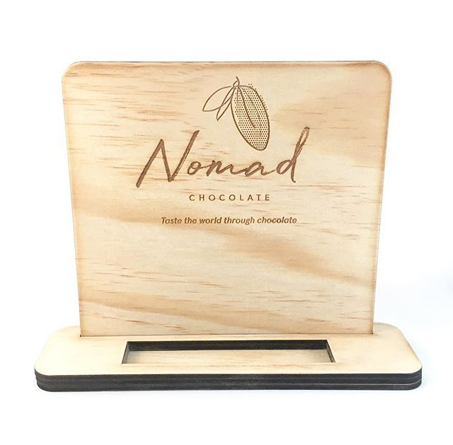 Custom Business Card Holder . . Just one of the branded goodies off to Dubai today with @nomadchocolate for a trade fair . . Display stands card holders A4 signage and a brochure holder... perfect combo to showcase an amazing product on the world stage! . . . #amandalalife #lasercut #woodensigns #businesscardholder #custommade #chocolate #australianmade #maker #themakersmaker #bespoke #branding #retaildisplay #marketstall