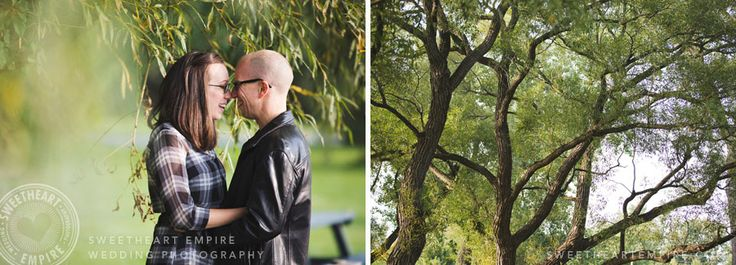 Kissing and laughing in the greenery. Wards Island Engagement photos #torontoisland #sweetheartempirephotography