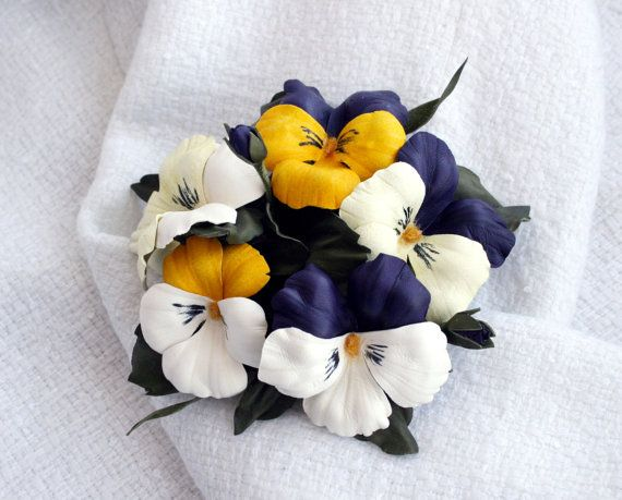 Hey, I found this really awesome Etsy listing at https://www.etsy.com/listing/187790647/leather-pansies-flowers-brooch