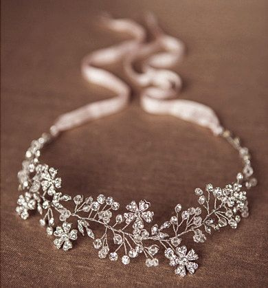 The Stacey Stunning handcrafted beaded bridal headpiece is a stunning flexible wire vine of silver plated flower charms, clear tear-drop