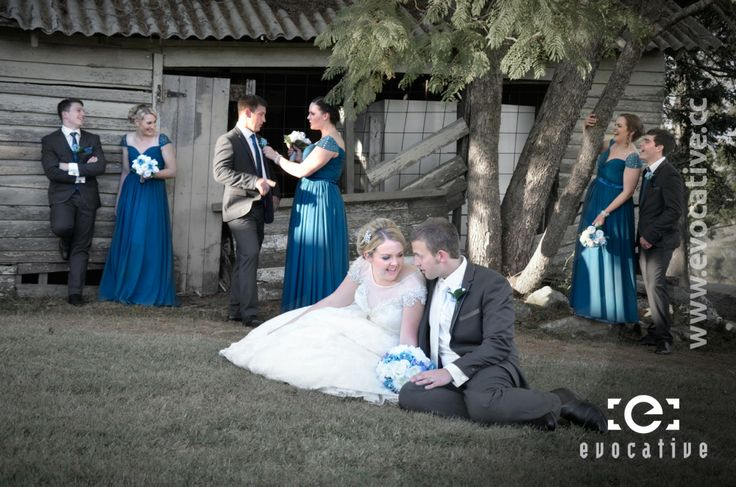 Wedding party of eight telling jokes outside the old barn at Woodlands of Marburg. #WeddingPhotography