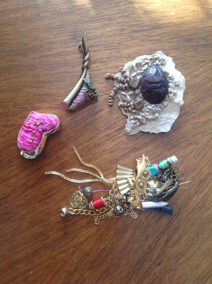 Brooches with embroidery and found objects by Margaret Roberts.