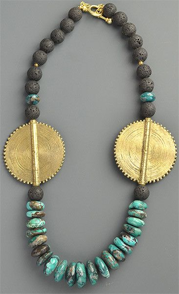 This necklace was crafted by store co-owner Emily Hunter Silverman. She used a bold combination of materials, including carved black lava beads, Chinese turquoise, and large Ashanti brass medallions.