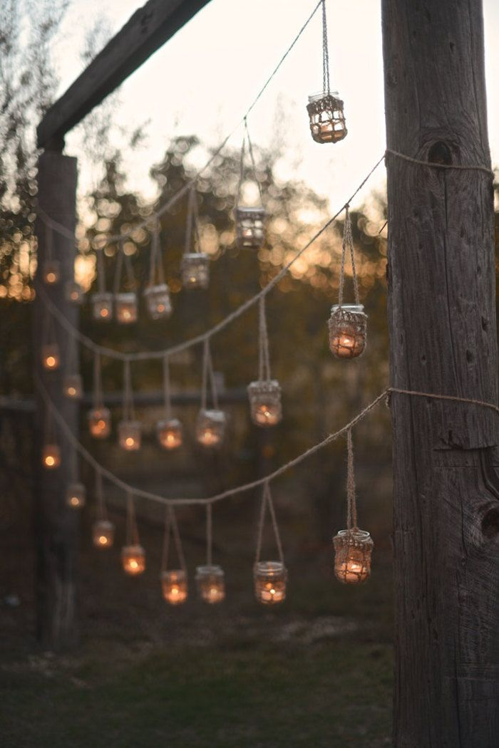 For a garden party wedding or backyard wedding, hang candles or votive holders with these rustic twine hangers by SpindleShuttleNeedle.